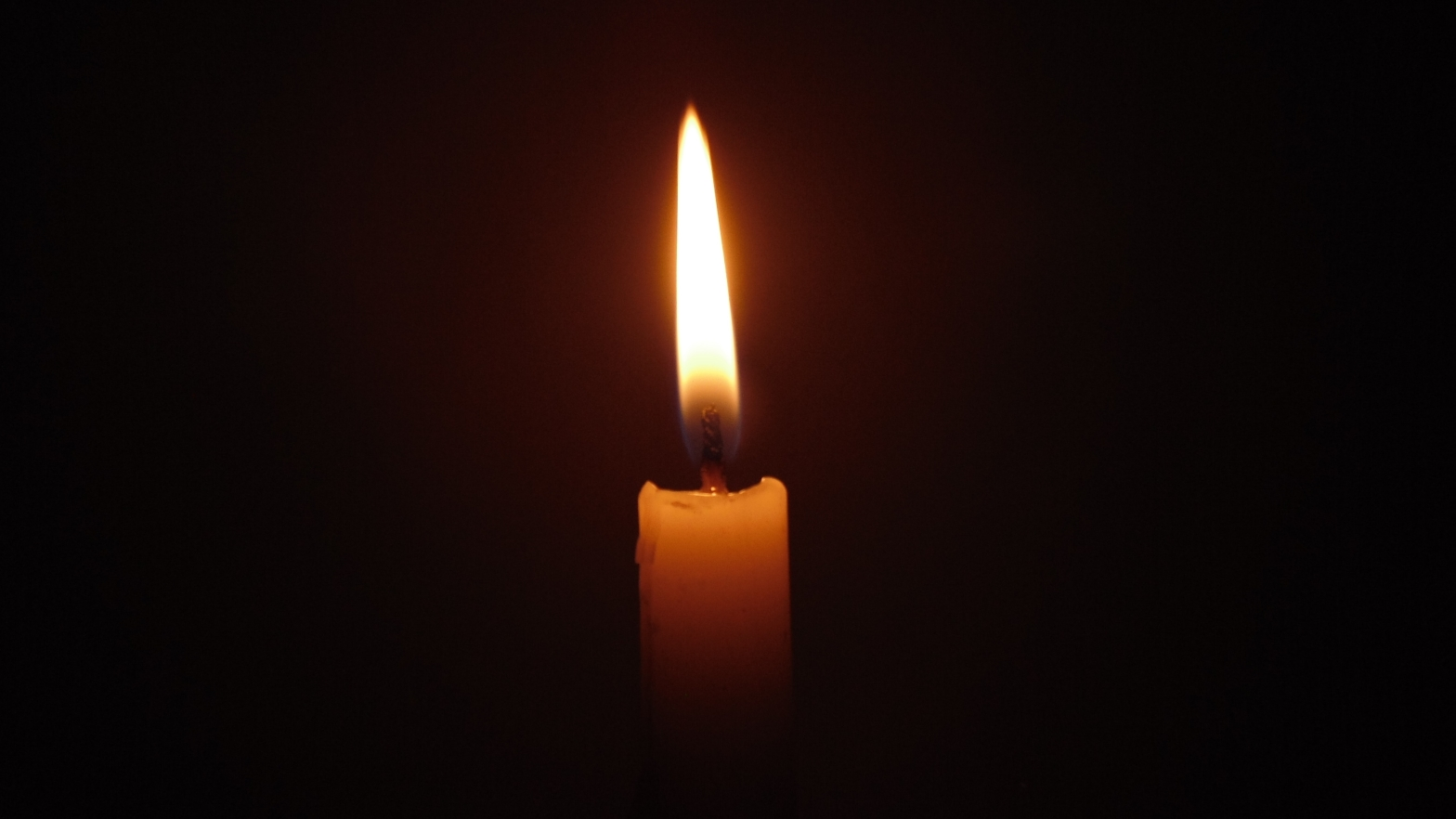 Image is of a lit candle