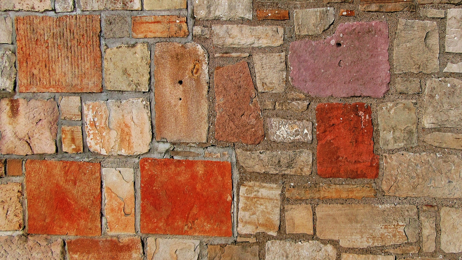 Image shows a close up of an irregular brick path